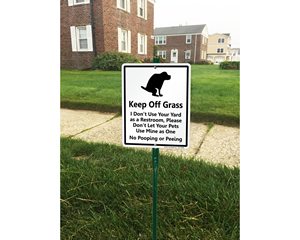 Dogs keep off of the grass signs
