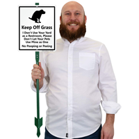 Dogs keep off of grass sign